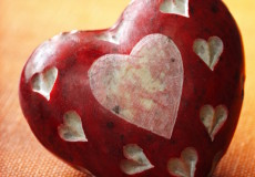 Carved stone red heart showing love