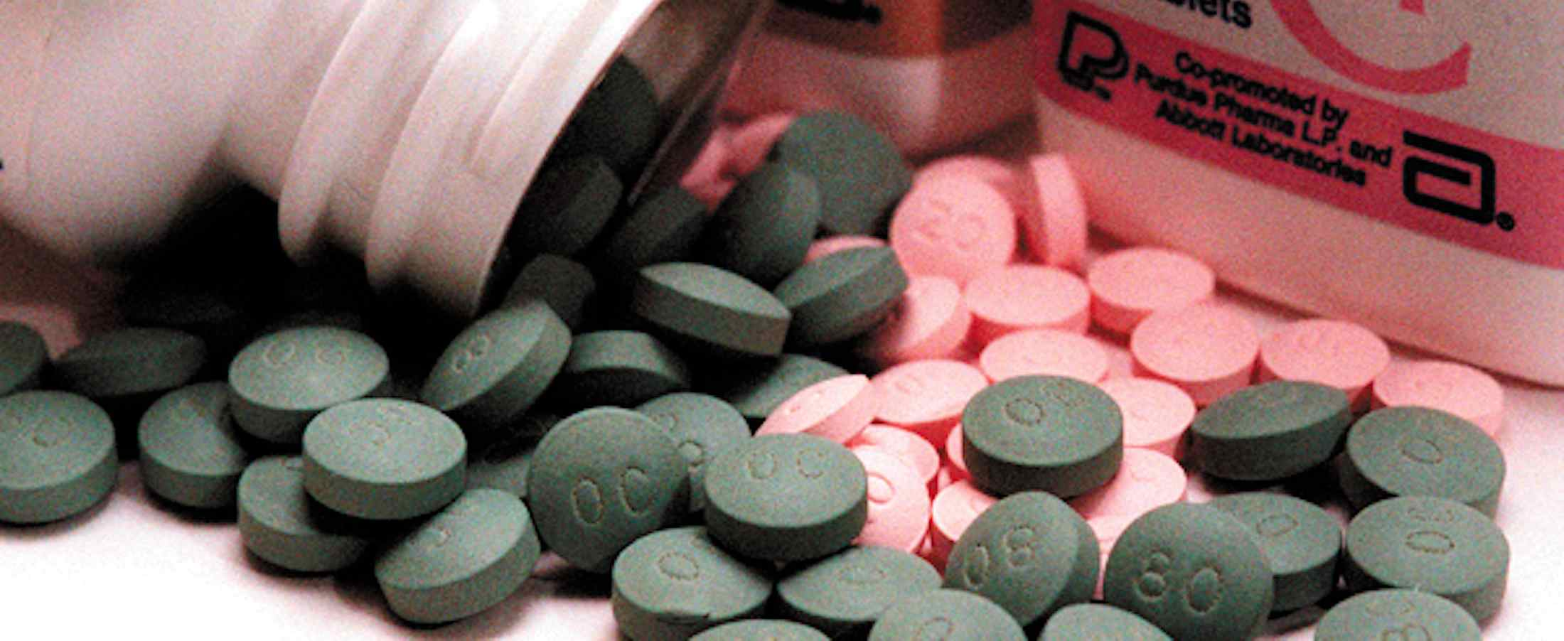 Oxycontin and Fentanyl pills spilling out of pill bottles